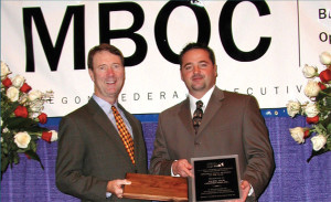 Right: Pacific Tech President Joe Lane Receiving SBA Small Business of the Year Award.